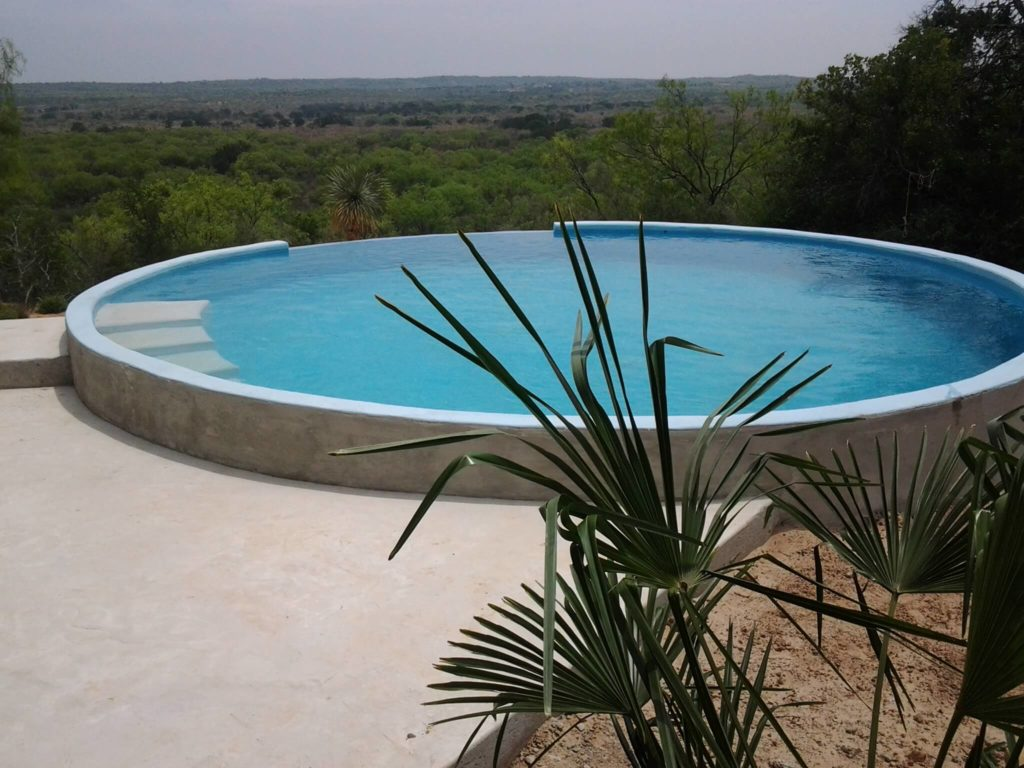 A pool made from a stock tank.